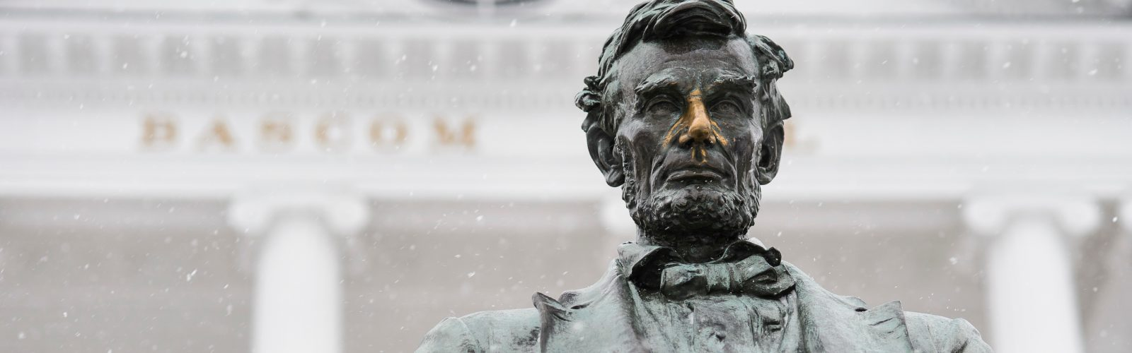 A light snow falls on the Abraham Lincoln statue in front of Bascom Hall at the University of Wisconsin-Madison