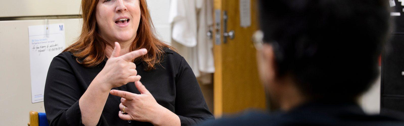 sign language interpreter signs